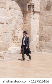 Jerusalem, Israel - June 14, 2018: An ultra-orthodox jewish or Haridi man in traditional religious outfit walking in the old city of Jerusalem.