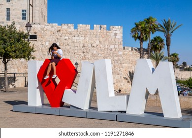 Jerusalem, Israel - June 14, 2018: I Love JLM (short for Jerusalem) statue and people taking photos with it at Tsahal Square, Jerusalem.