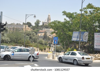 Jerusalem, Israel, June 16, 2010: One of the crossroads of Jerusalem in the summer. Cars, taxis, buildings, church. Day of Jerusalem