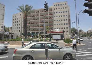 "Jerusalem, Israel, June 16, 2010: Crossroads of the city with cars and people. Hotel ""Prima ha mlahim."" The Day of Jerusalem"