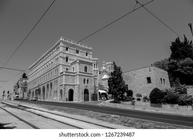 Jerusalem, Israel - June 16, 2018: View of Tsahal Square with St. Louis French Hosptial and cars in traffic, Jerusalem, Israel