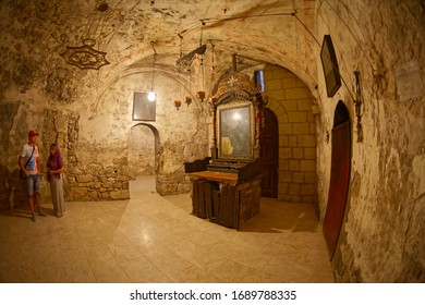 JERUSALEM, ISRAEL - JUNE 19, 2015: Fisheye lens shot of the Tomb of Joseph of Arimathea or Abyssinian connecting the Rotunda containing Christ's tomb in Church of the Holy Sepulchre.