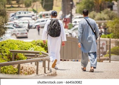 JERUSALEM, ISRAEL. June 20, 2017. Two young Muslim tourists walking on the streets of Jerusalem by the Damascus gate of the Old city. Radical Muslim youth in Europe, US illustrative stock image.
