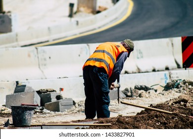 Jerusalem Israel June 24, 2019 View of worker building a new road in Jerusalem in the afternoon