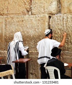 JERUSALEM, ISRAEL - MARCH 03: Jewish worshipers  pray at the Wailing Wall an important jewish religious site  on March 03, 2012  in Jerusalem, Israel