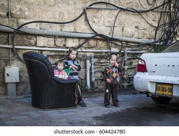 JERUSALEM, ISRAEL - MARCH 06, 2017: Orthodox quarter of the city. Children of the Hasidim (Orthodox Jews)