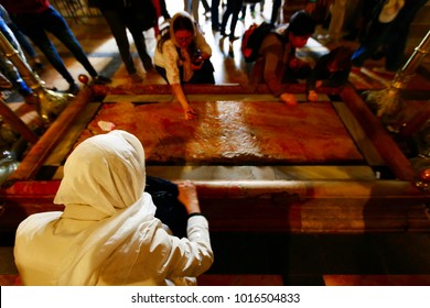 Jerusalem, Israel- March 12, 2017: Pilgrims at the The Stone of Anointing, where Jesus' body is said to have been anointed before burial.