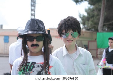 Jerusalem , ISRAEL - MARCH 15, 2016:  Purim carnival in the famous ultra-orthodox quarter of Jerusalem - Mea Shearim. Group portrait of  children dressed in carnival costumes.