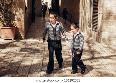 JERUSALEM, ISRAEL - MARCH 22, 2014: Two jewish kids in holy city Jerusalem on March 22, 2014, Israel