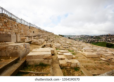 JERUSALEM, ISRAEL - MARCH 25, 2019: View to jewish cemetery and old Jerusalem.