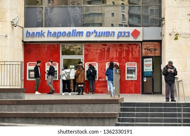 JERUSALEM, ISRAEL - MARCH 3, 2019: People using cash machine in ATM cash point in a branch of Bank Hapoalim on Zion Square in West Jerusalem.