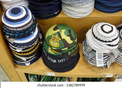JERUSALEM, ISRAEL - MARCH 3, 2019: A variety of crocheted kippot for sale. Kippah printed with IDF emblem for sale in a store.