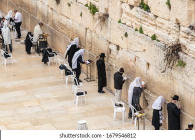 Jerusalem, Israel, March 3, 2020 : Jewish believers pray near the Kotel in the Old Town of Jerusalem in Israel