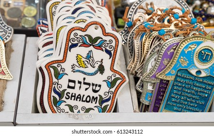 "JERUSALEM, ISRAEL - MARCH 31, 2017: Hamsa with ""Shalom"" (Peace) sale sale at Mahane Yehuda Market, popular marketplace in Jerusalem, Israel"