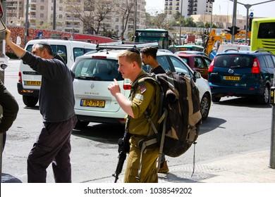 Jerusalem Israel March 4-2018 Unknowns people walking in Yafo street near the central bus station in Jerusalem noon