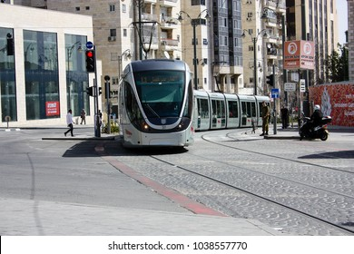 Jerusalem Israel March 4-2018 View of the tramway of Jerusalem and unknowns people walking at central station in Yafo street noon