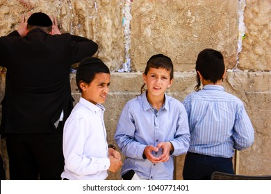 Jerusalem Israel  March 6-2018 Unknowns kids standing front the Western wall at the old city of Jerusalem morning