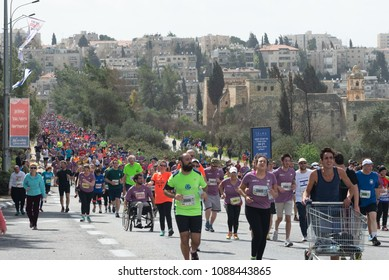 JERUSALEM, ISRAEL - MARCH 9, 2018:  Unidentified runners in the Jerusalem Marathon pass the Eastern Orthodox Monastery of the Cross in the Valley of the Cross.