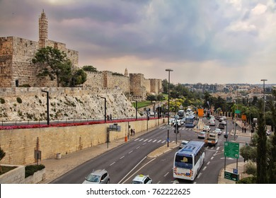 JERUSALEM, ISRAEL - MAY 11, 2014: Car traffic on Khativat Yerushalayim Street walls of Old City near Jaffa Gate. Walls were built in 1538, under Suleiman the Magnificent. Old City listed as UNESCO sit