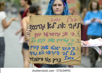 Jerusalem, Israel- May 13, 2016: The 5th 'SlutWalk' march in Jerusalem. A protester holding a sign in Hebrew with the title 'But honey, Why don't you smile'