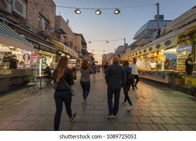 Jerusalem, Israel - May 13, 2018: Shoppers walking through the Yehuda Market after sunset.