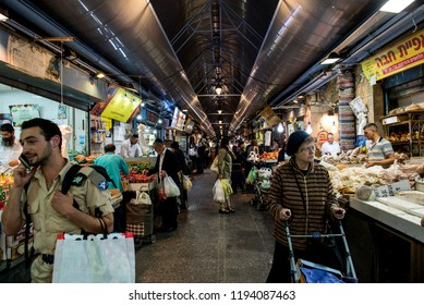 JERUSALEM, ISRAEL - MAY 15, 2016: Tourists and local Jewish people visiting the local market of the Holy city, the Machane Yehuda