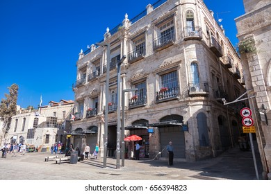 JERUSALEM, ISRAEL - MAY 16, 2014: People walking about in Old Jerusalem, in front of the New Imperial Hotel close to the Jaffa gate within walking distance to the Church of the Holy Sepulchre