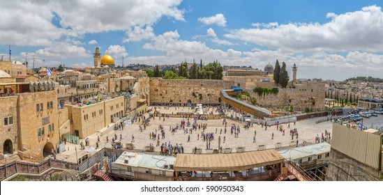 JERUSALEM, ISRAEL - MAY 23, 2016: Panoramic view of the prayers making their wishes and prays at the Western Wall, located in the Old City at the foot of the western side of the Temple Mount.