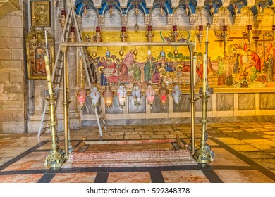 JERUSALEM, ISRAEL - MAY 24, 2016: The Stone of Anointing, where Jesus' body is said to have been anointed before burial, in Church of the Holy Sepulchre in Jerusalem Israel.