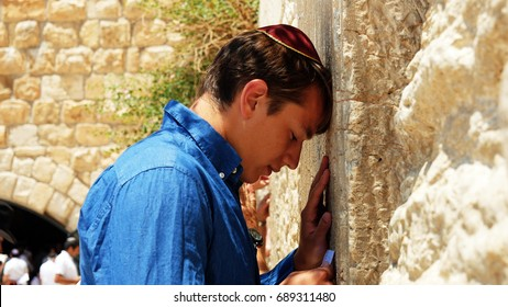 Jerusalem, Israel - May 25, 2017: Jewish man pray at the Western Wall also known as Wailing Wall or Kotel in Jerusalem. The Western Wall is the most sacred place for all jews and jewish in the world.