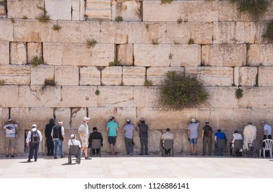 Jerusalem, Israel - may 3, 2015: Wall of lamentation and devotees of the Jewish religion praying in front of it