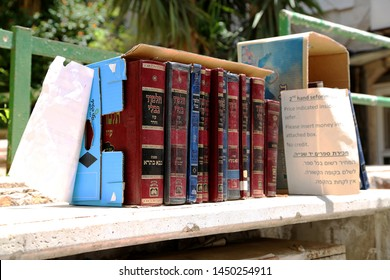 Jerusalem, Israel - May 5, 2018 Jewish sacred books Torah on bookshelf library for prayer at synagogue. Books Torah from wooden bookcase in Hebrew library. Retro book Rack Torah off islamic library.