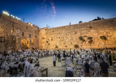 Jerusalem, Israel - May 8, 2016: Jewish worshipers praying at dawn in front of  the Western Wall