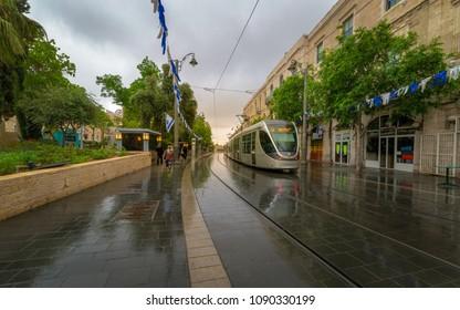 Jerusalem, Israel - May 8, 2018: The light train on Jaffa street shortly before sunrise.