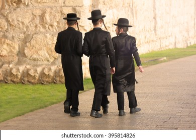 JERUSALEM, ISRAEL - NOV 23, 2013: Jewish kids walking outside Jerusalem Walls.