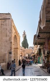 Jerusalem, Israel, November 17, 2018 : Shuk Hatsabaim street leading to Church of the Holy Sepulchre in old city of Jerusalem, Israel