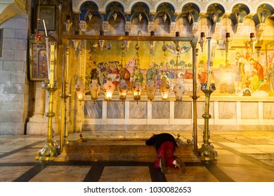JERUSALEM, ISRAEL - NOVEMBER 19, 2016 Anointing Unction Stone Where Jesus Body Was Wrapped Church of the Holy Sepulcher Jerusalem Israel. Church expanded in 1170 AD contains Jesus Tomb and Golgotha,
