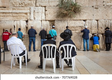 JERUSALEM / ISRAEL - NOVEMBER 19, 2016: People praying to their religion at the Wailing Wall or Kotel in historic old city of Jeruslam.
