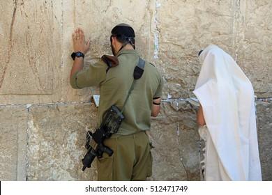 Jerusalem, Israel - November 2 , 2016: Soldier and jewish Prayer at the Western Wall in Jerusalem. Israel