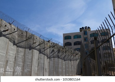 Jerusalem, Israel, November 23, 2010: A concrete wall built by Israel to stop West Bank Palestinians from commuting in East Jerusalem.