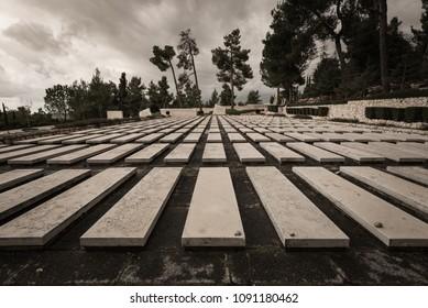 Jerusalem, Israel - November 23, 2017: Graves of Israeli soldiers killed in wars at Mount Herzl Military Cemetary.