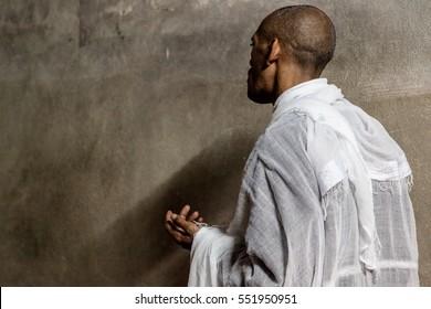 Jerusalem, Israel - November 24, 2013: An Ethiopian monk meditates in Ethiopian Chapel in the Church of Holy Sepulchre in Jerusalem.