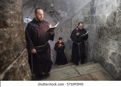 Jerusalem, Israel - November 26, 2013: Franciscan monks in the Church of Holy Sepulchre during their daily precession.