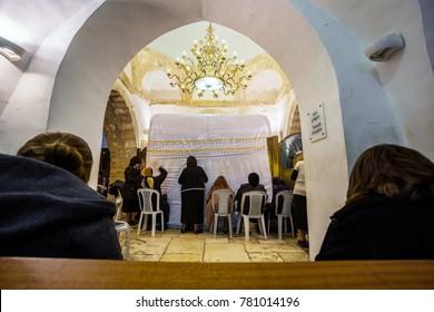 Jerusalem. Israel - November 3, 2015: Women praying in Rachel's Tomb Synagogue, Jerusalem, Israel