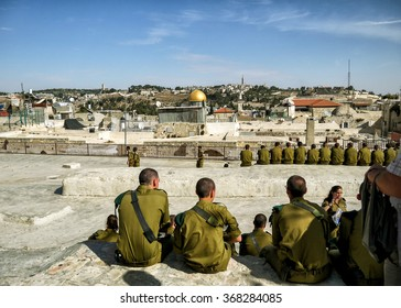 JERUSALEM, ISRAEL - NOVEMBER 4, 2012: Israeli soldiers on an excursion in the old city, Jerusalem. Jerusalem - the ancient city that attracts many tourists.