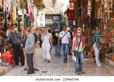 Jerusalem, Israel - November 9, 2014 : Tourists and locals at Jerusalem's old city market known for it's colorful oriental goods, from souvenirs to traditional middle esters food.