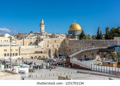 Jerusalem, Israel - Oct 28th 2018 - The wall in the city of Jerusalem in a blue sky day with people praying in front of it