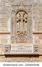 JERUSALEM, ISRAEL, October 05 2018: Memory cross dedicated to the Armenian victims in 1915 incorporated into walls of Old City of Jerusalem in Israel.
