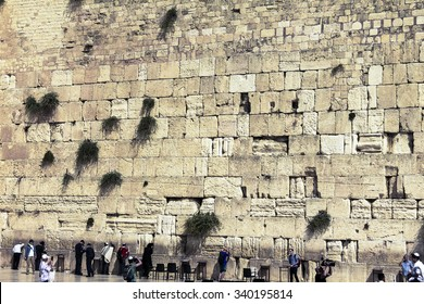 JERUSALEM, ISRAEL - OCTOBER 13, 2015: Unidentified jewish worshipers pray at the Wailing Wall an important jewish religious site