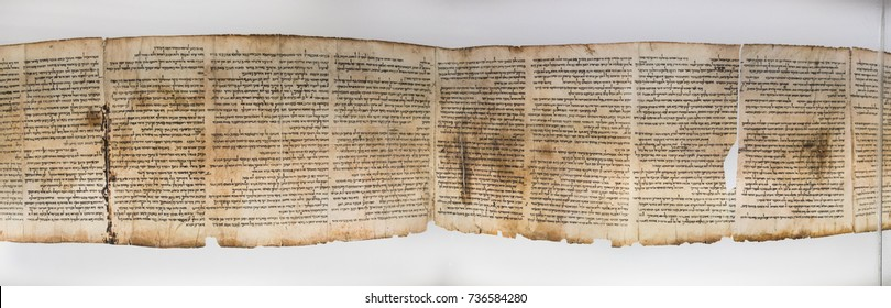 JERUSALEM, ISRAEL - OCTOBER 13, 2017: One of Dead Sea Scrolls, displayed in Shrine of the Book. Israel Museum, Jerusalem. Israel.